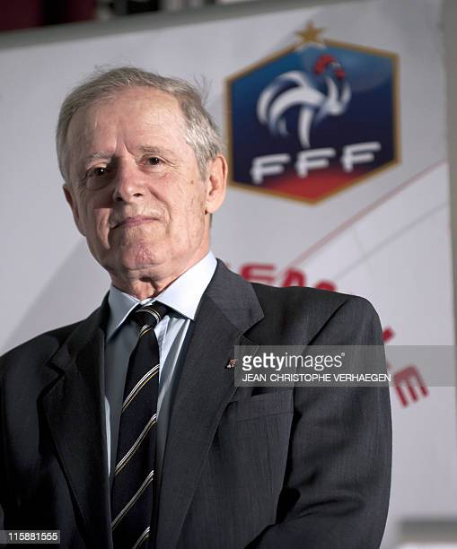 UEFA president Michel Platini's father Aldo poses on June 11 after being decorated by his son with a Golden order of the French Football Federation...