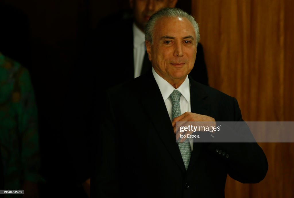 President Michel Temer arrives to deliver a statement on May 18, 2017 in Brasilia, Brazil. The statements follow the release of a recording of Temer allegedly condoning bribery payments to Eduardo Cunha, the former President of the Chamber of Deputies. Cunha was involved in the 'Lava Jato' (Car Wash) corruption scandal and sentenced to 15 years in prison after being found guilty of corruption, money laundering and illegal money transfers abroad. With the release of the recording, the opposition has called for Temer's impeachment and new elections.