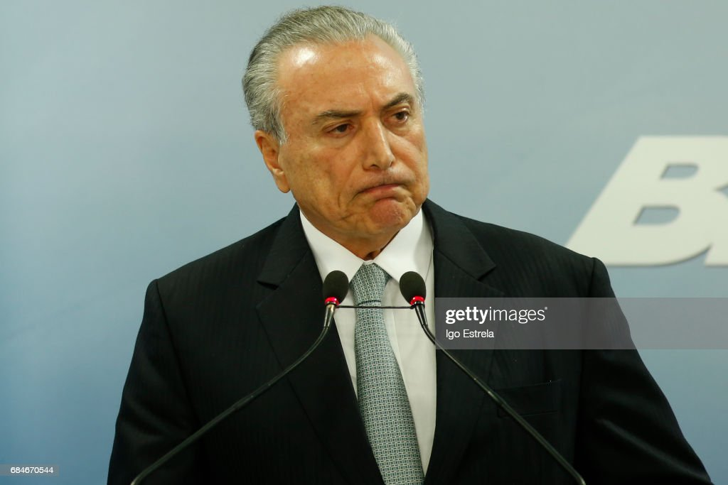 President Michel Temer delivers a statement on May 18, 2017 in Brasilia, Brazil. The statements follow the release of a recording of Temer allegedly condoning bribery payments to Eduardo Cunha, the former President of the Chamber of Deputies. Cunha was involved in the 'Lava Jato' (Car Wash) corruption scandal and sentenced to 15 years in prison after being found guilty of corruption, money laundering and illegal money transfers abroad. With the release of the recording, the opposition has called for Temer's impeachment and new elections.