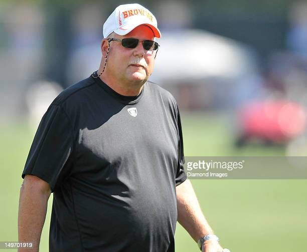 President Mike Holmgren of the Cleveland Browns walks off the field after practice at the Cleveland Browns Headquarters in Berea Ohio on August 1 2012