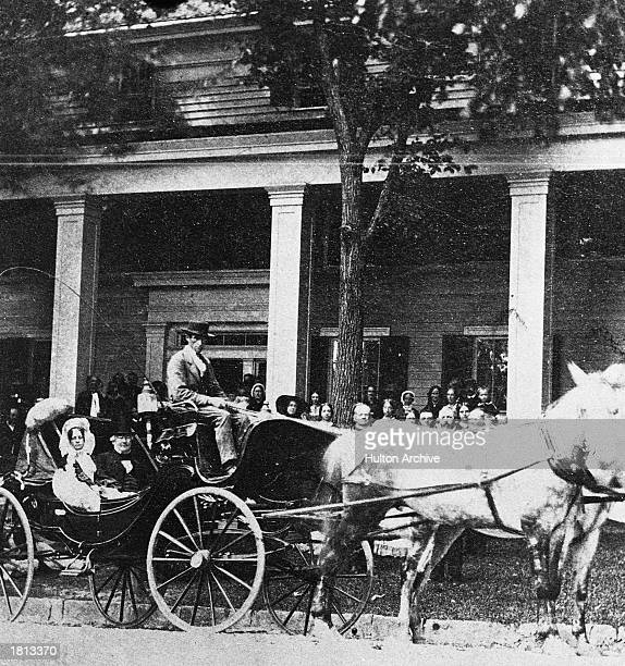 US president Millard Fillmore and First Lady Abigail Fillmore sit in the back of a horsedrawn carriage while vacationing in Saratoga Springs New York...