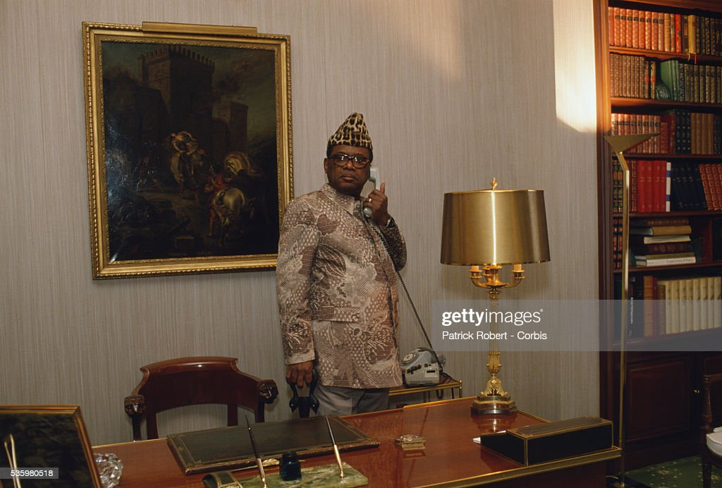 President Mobutu Sese Seko of Zaire makes a phone call in his Avenue Foch office in Paris. Mobutu (1930-1997) created a nationalistic state in Zaire, later the Democratic Republic of the Congo, and built his personal wealth on foreign aid and corruption.