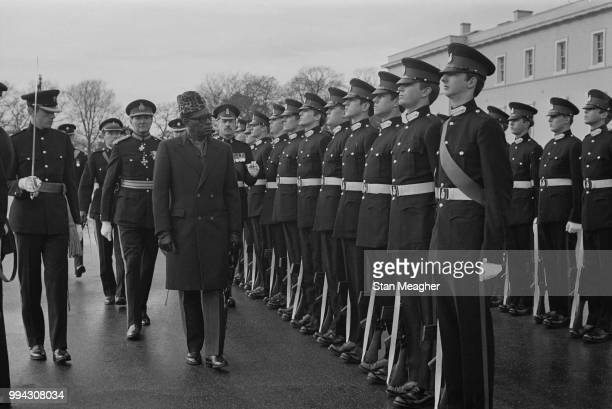 President Mobutu Sese Seko of Zaire pictured inspecting a line of graduating British Army officers at the Royal Military Academy Sandhurst in...