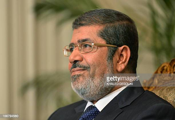 President Mohamed Morsi attends a meeting with UN Secretary General Ban Ki-moon at the presidential palace in Cairo on November 21, 2012. Ki-moon...