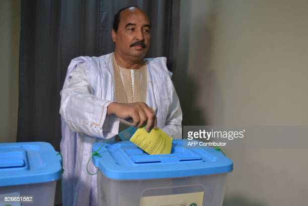 President Mohamed Ould Abdel Aziz of Mauritanian casts his vote in the country 's constitutional referendum on August 5 2017 at the polling station...
