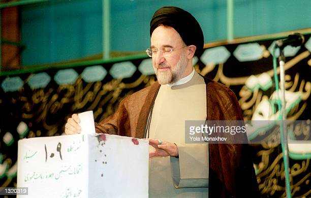 President Mohammed Khatami casts his ballot in the presidential election at the Hosseinieh Jamaran mosque June 8, 2001 in northern Tehran, Iran....