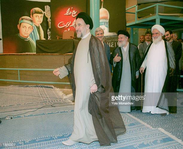 President Mohammed Khatami walks into the Hosseinieh Jamaran mosque to cast his ballot in the presidential elections June 8, 2001 in northern Tehran,...