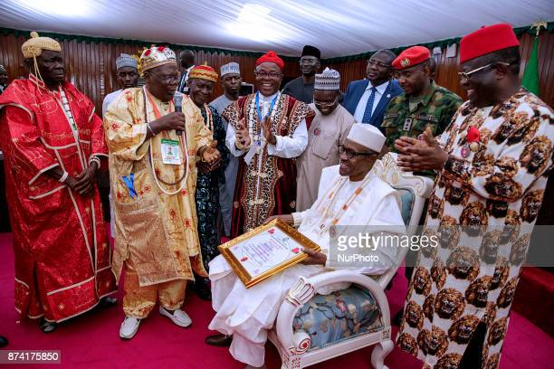 President Muhammadu Buhari conferred with the title of Ochioha NdiIgbo 1 by South East traditional council of rulers led by Eze Eberechi Dick during...