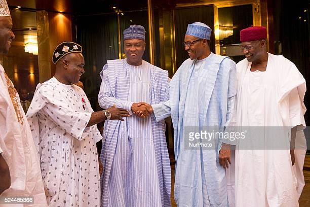President Muhammadu Buhari receive list of confirmed screen ministers from Senate president Bukola Saraki in Abuja Nigeria November 3 2015
