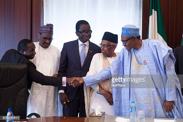 President Muhammadu Buhari with the Chairman Flour Mills Nigeria Ltd Mr John Coumantaros Alh Ahmed Joda Minister of Agriculture Chief Audu Ogbeh and...