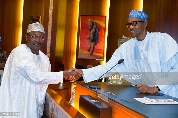 President Muhhamadu Buhari congratulating INEC chairman Prof Mahmoud Yakubu shortly after his swearing in as INEC Chairman in Abuja on 9th Nov 2015