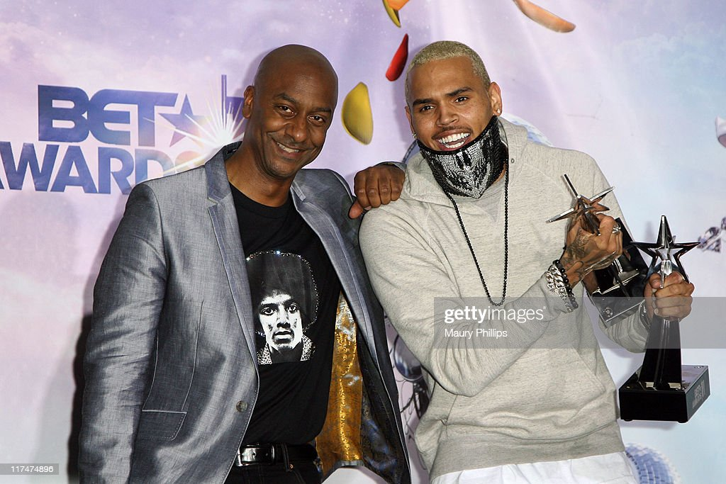 President, Music Programs and Specials, Stephen Hill (L) poses with singer Chris Brown in the press room at the BET Awards '11 held at The Shrine Auditorium on June 26, 2011 in Los Angeles, California.