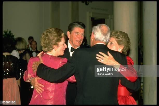 President Nancy Reagan embracing British PM Margaret Denis Thatcher during State Dinner