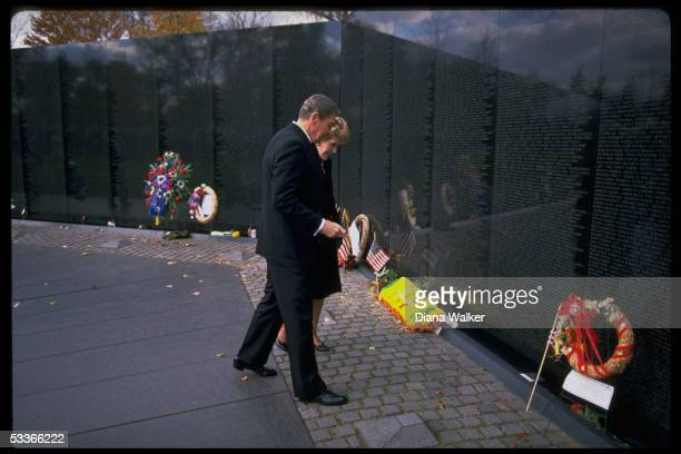 President Nancy Reagan marking Veteran's Day with ceremony at Vietnam Memorial scanning names etched in stone