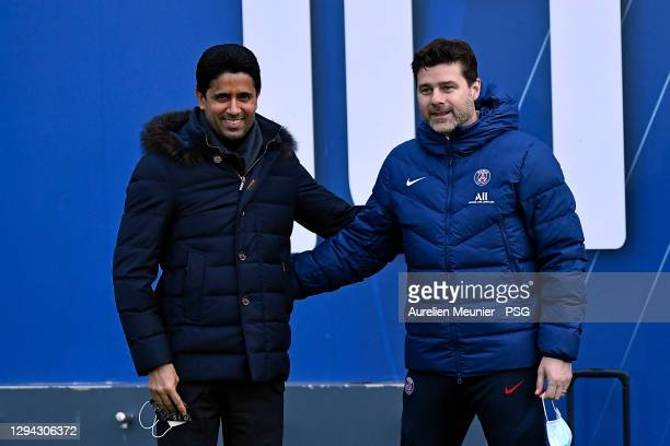 President Nasser Al Khelaifi and newly appointed head coach Mauricio Pochettino pose before a Paris Saint-Germain training session at Ooredoo Center...