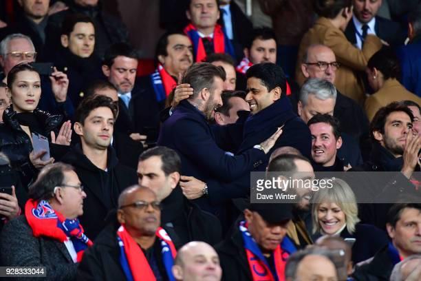 PSG president Nasser AlKhelaifi greets former PSG player David Beckham during the UEFA Champions League Round of 16 second leg match between Paris...