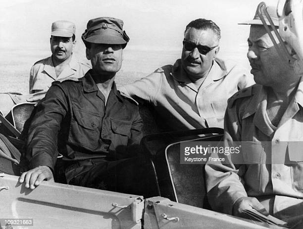President Nasser and President Gaddafi are Sitting in a jeep and watching the manoeuvres while in front is MajorGeneral Mohammed Fawzi the Egyptian...