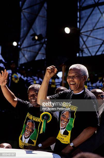 President Nelson Mandela and deputy president Thabo Mbeki greet followers during the start of the election campaign on February 28, 1999 in Soweto,...