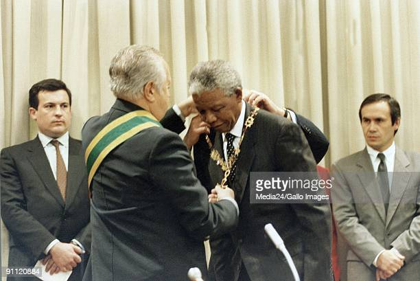 President Nelson Mandela and president Mario Soares of Portugal handing over awards to each other