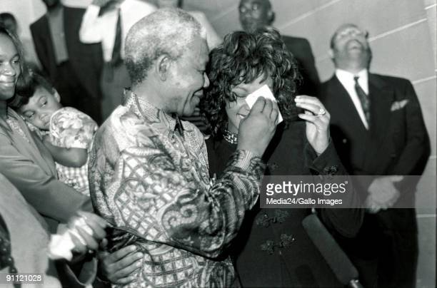 President Nelson Mandela being like a concerned parent wiping the tears of a very emotional Whitney Houston where she met Mr Mandela on the steps of...