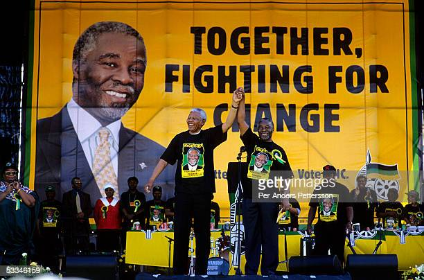 President Nelson Mandela holds the hand of deputy president Thabo Mbeki during the start of the election campaign on February 28 1999 in Soweto South...