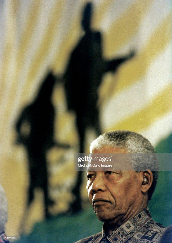 President Nelson Mandela listens attentively.