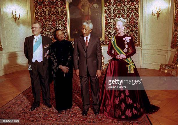 President Nelson Mandela of South Africa and his wife Graca Machel with Queen Margrethe of Denmark and Prince Henrik of Denmark at Amalienborg Palace...