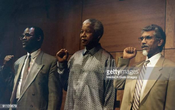 President Nelson Mandela On the right is Mac Maharaj