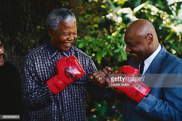 President Nelson Mandela pretends to spar with boxer Marvin Hagler at home in Cape Town President of South Africa and longtime political prisoner...