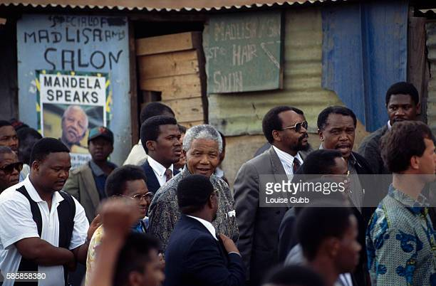 President Nelson Mandela tours the poverty stricken township of Alexandra in Johannesburg President of South Africa and longtime political prisoner...