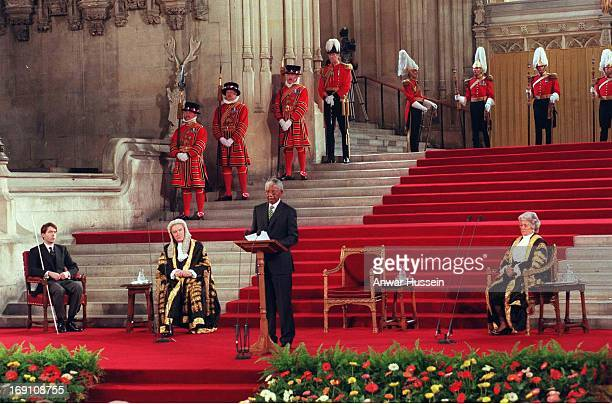 President Nelson Mandela watched by Lord MacKay and Betty Boothroyd delivers a speech at the Palace of Westminster during his State Visit to Britain...