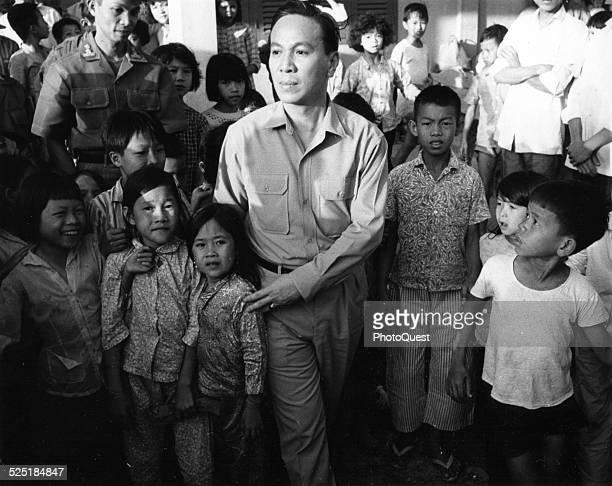 President Nguyen Van Thieu tours a refugee center in the Mekong Delta during the Vietnam War 1968