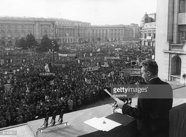President Nicolae Ceausescu Romanian President and dictator giving a speech at a big civic rally in Bucharest The crowd in the square are carrying...