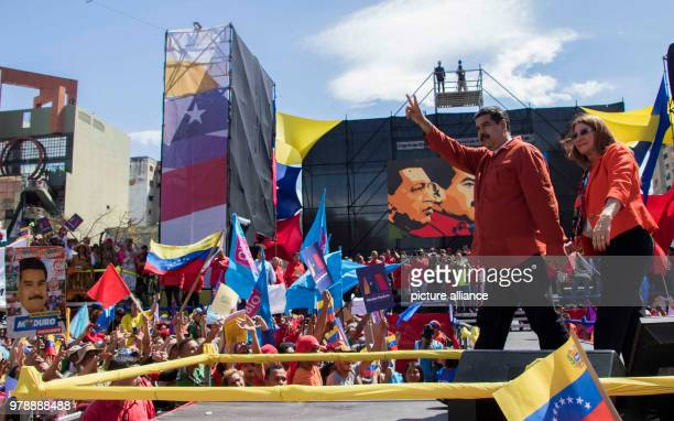 President Nicolas Maduro and his wife Cilia Flores appearing in front of supporters during a rally in the capital Caracas Venezuela 27 February 2018...