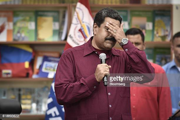 President Nicolas Maduro pauses while addressing supporters during a rally in Caracas Venezuela on Friday Oct 28 2016 After rallying tens of...