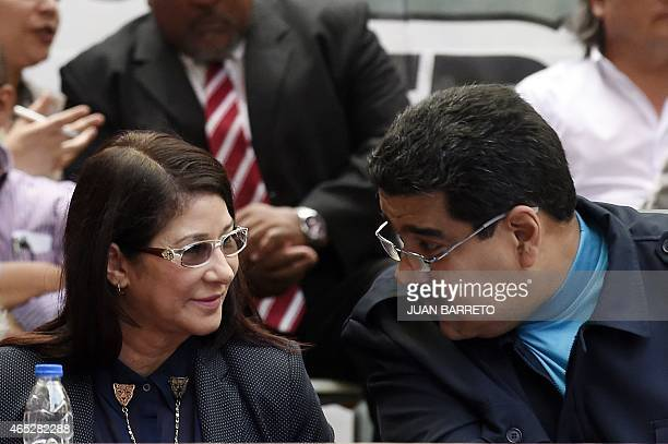President Nicolas Maduro speaks with Venezuelan First Lady Cilia Flores during a ceremony commemorating the second anniversary of former Venezuelan...
