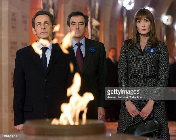President Nicolas Sarkozy and Carla BruniSarkozy look at the eternal flame during commemorations of the 90th anniversary of the end of WWI on...