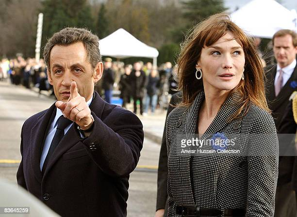 President Nicolas Sarkozy of France and his wife Carla BruniSarkozy take part in commemorations of the 90th anniversary of the end of WWI on November...