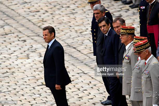 President Nicolas Sarkozy, Prime Minister Francois Fillon and Defence Minister Herve Morin attend a memorial ceremony at Les Invalides for the ten...