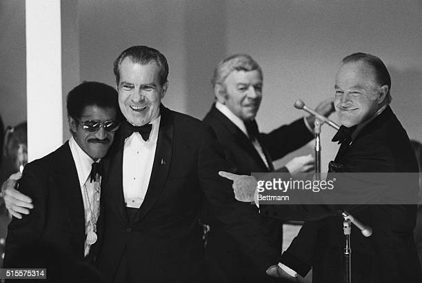 President Nixon hugs Sammy Davis Jr as Bob Hope and bandleader Les Brown look on at the White House gala for returned prisoners of war 5/24 The...