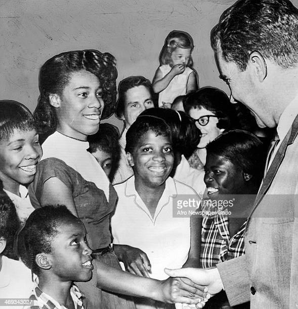 President Nixon is greeted by the crowd upon his arrival at Greensboro High Point airport, with a young woman shaking his hand, Greensboro, North...