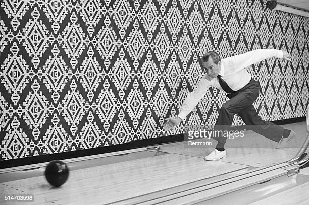 President Nixon is the picture of concentration as he releases bowling ball at Executive Office Building lanes Sept 17 However the camera catches Mr...