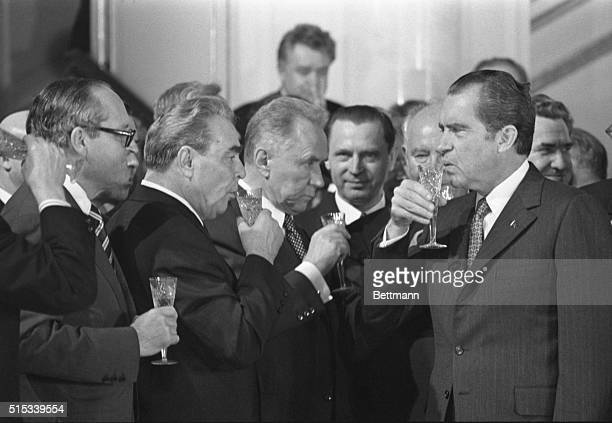 President Nixon joins Communist Party chief Leonid Brezhnev and Alexei Kosygin in a toast to the signing of the historic treaty to halt the arms race...