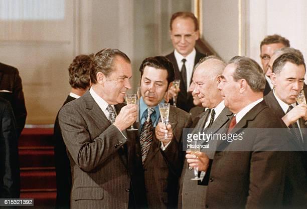 President Nixon Nikolai Podgorny and Leonid Brezhnev celebrate the signing of the SALT treaty with champagne