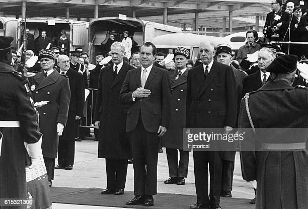 President Nixon stands with Charles De Gaulle during welcoming ceremonies at Orly airfield France