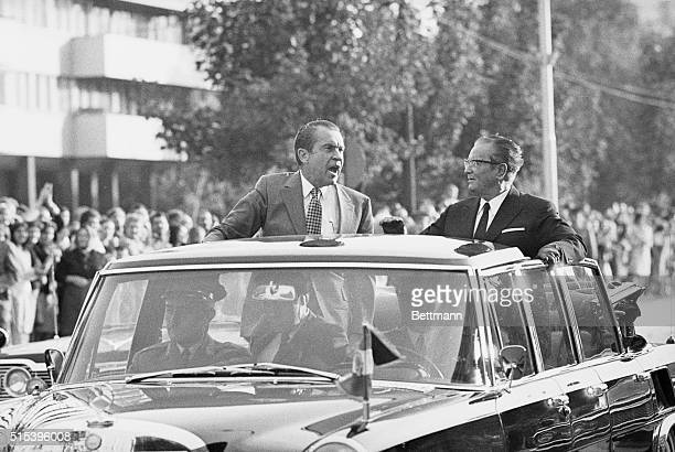 President Nixon waves from a car as he rides with Yugoslavia's President Tito in motorcade through the capital city of Belgrade September 30th