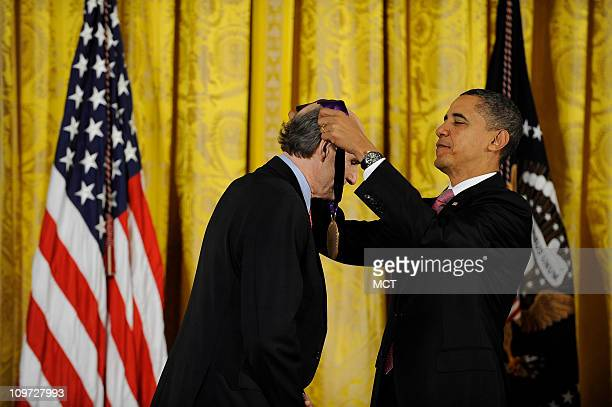 President Obama awards a 2010 National Medal of Arts and National Humanities Medal to James Taylor in the East Room at the White House in Washington...