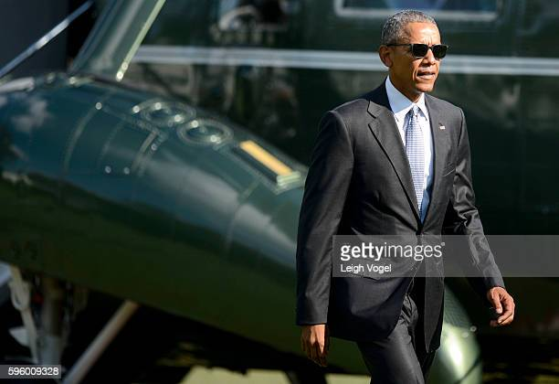 President Obama departs Marine One and walks toward the Oval Office after visiting wounded service members at Walter Reed National Military Medical...