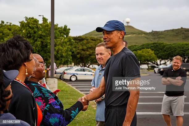 President Obama greets well wishers at Marine Corps Base Hawaii during his December 2014 annual vacation with the First Family in Kailua, Hawaii on...