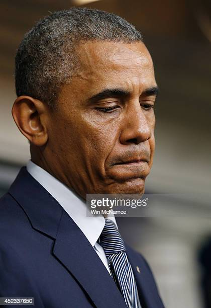 President Obama pauses while delivering a statement on the Malaysia Airlines crash over eastern Ukraine in the Brady Press Briefing Room of the White...